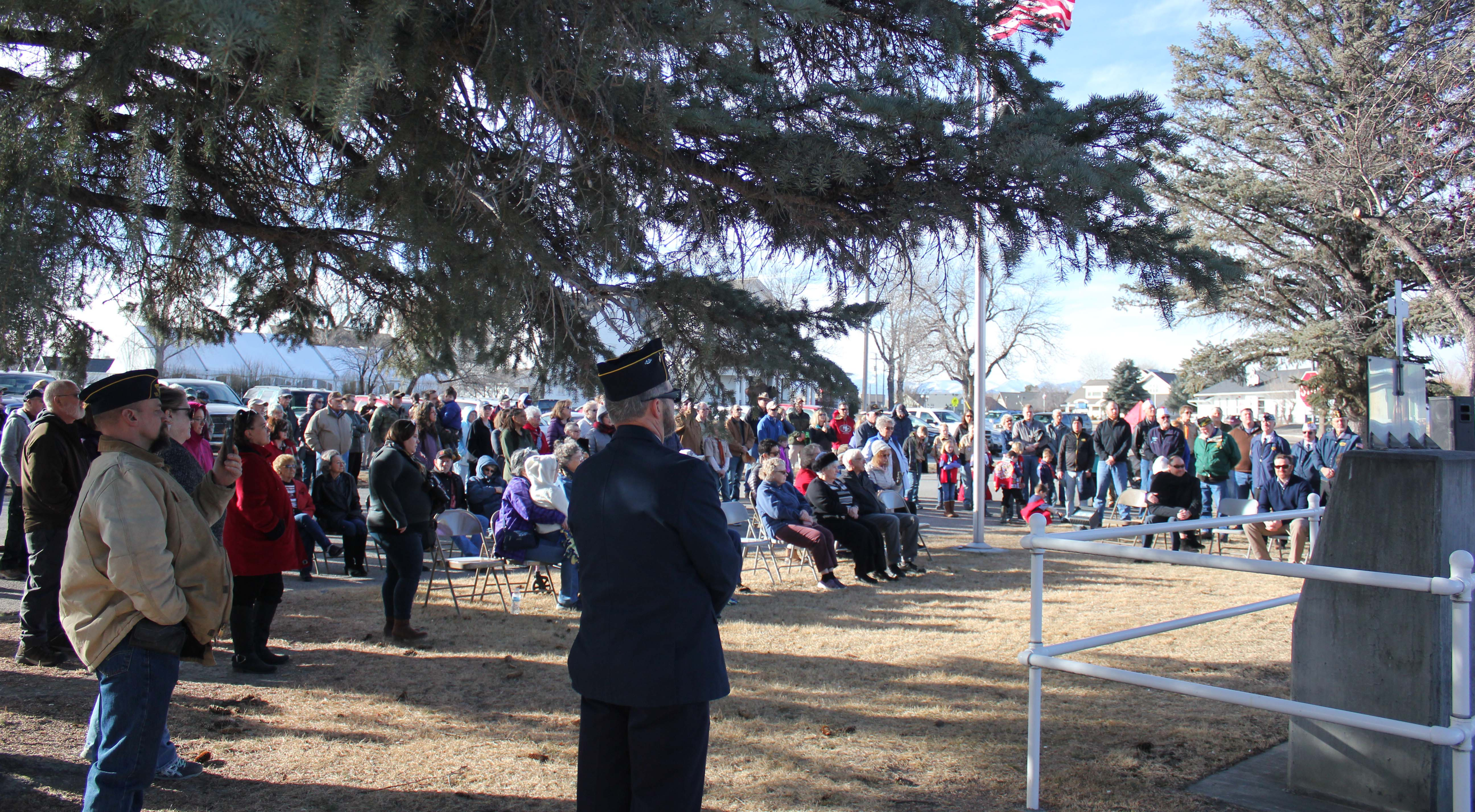 Crowd gathers for the dedication of the 442nd memorial in Three Forks.
